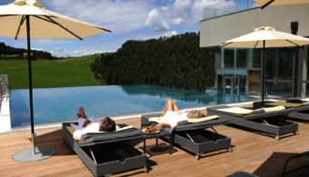 Relaxation at the pool at Hotel Alpenflora in Castelrotto